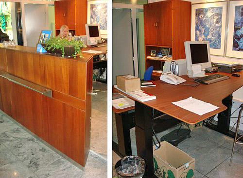 Ombygning af mahogni receptionsskranke og skabe samt levering af højdejusterbare arbejdsborde med faconfræsede mahogniplader.  Udført for Icopal,  Herlev